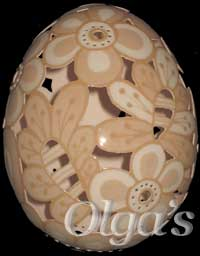 Etched and carved brown chicken egg.